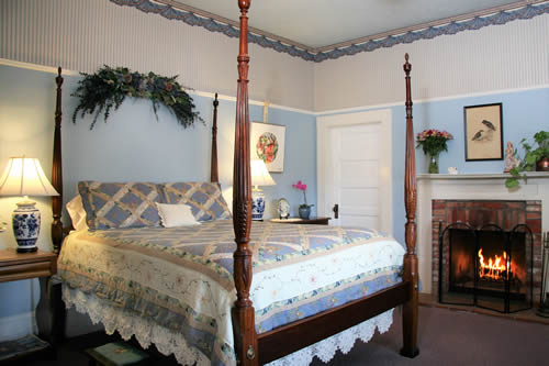 healdsburg bed and breakfast guestroom with bed and fireplace