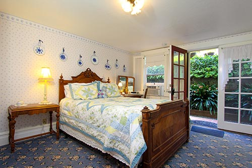 healdsburg bed and breakfast guestroom with bed and sitting area plus french doors